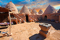 "Pictures of the beehive adobe buildings of Harran, south west Anatolia, Turkey.  Harran was a major ancient city in Upper Mesopotamia whose site is near the modern village of Altınbaşak, Turkey, 24 miles (44 kilometers) southeast of Şanlıurfa. The location is in a district of Şanlıurfa Province that is also named ""Harran"". Harran is famous for its traditional 'beehive' adobe houses, constructed entirely without wood. The design of these makes them cool inside. 26"