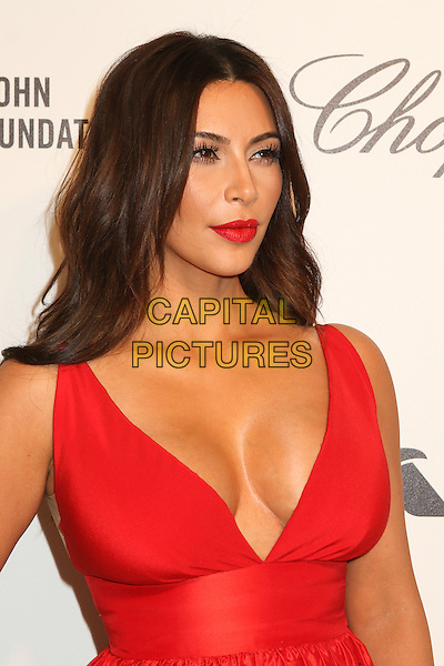 WEST HOLLYWOOD, CA - MARCH 2: Kim Kardashian attending the 22nd Annual Elton John AIDS Foundation Academy Awards Viewing/After Party in West Hollywood, California on March 2nd, 2014. <br /> CAP/MPI/COR99<br /> &copy;COR99/MediaPunch/Capital Pictures