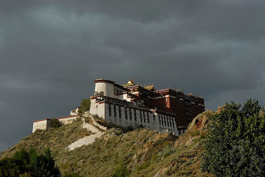 A big rainstorm approching the Potala in the late afternoon.Little remains of the original Potala Palace of the seventh century, built as a place for meditation by King Songtsen Gampo on the occasion of his marriage to Princess Wencheng of the Tang Court. Standing atop the Red Hill in Lhasa, the current structure dates from the 17th century; it was rebuilt by the 5th Dalai Lama and became the Winter Palace of the Dalai Lamas from that time. The 13-story building of 1,000 rooms can be seen from many miles away...The Potala is divided into two sections--an outer section, the White Palace, and an inner section, the Red Palace, the latter containing the temples and reliquary tombs of the Dalai Lamas. The entire building is a structure of stone and timber. At a height of 117 meters, the Potala was the world's tallest building until 20th-century architects designed cityscapes of new buildings that far surpassed the Potala in height--but not in its architectural majesty..