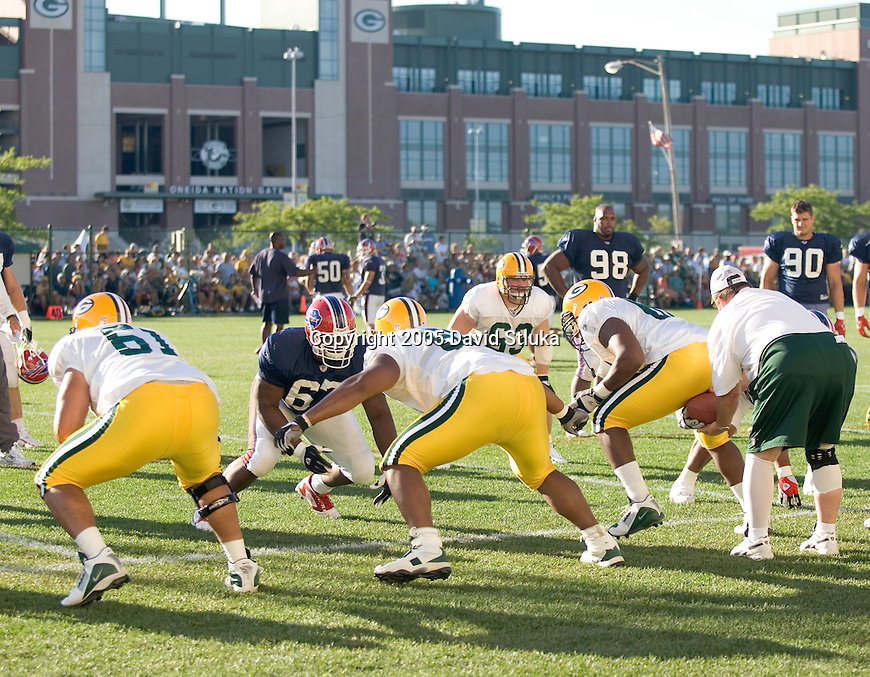 Defensive line of the Buffalo Bills battles the offensive line of the Green Bay Packers during a scrimmage on August 4, 2005 at the Don Hutson Center in Green Bay, Wisconsin. (Photo by David Stluka)