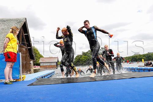 31.05.2014.  London, England.  Competitors in the lead group emerge from the water after the swim leg of the ITU World Triathlon Elite Men's race being held in Hyde Park.