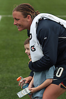 Abby Wambach of the USWNT poses for a photo with a young fan at the conclusion of the game in which she scored her 100th career goal in the second half. The U.S. Women's National Team defeated Canada 1-0 in a friendly match at Marina Auto Stadium in Rochester, NY on July 19, 2009.