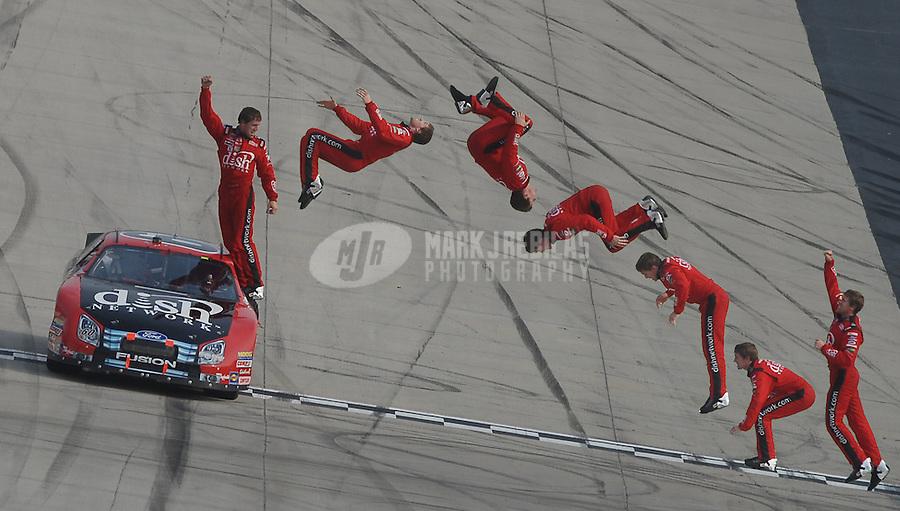 Jun 2, 2007; Dover, DE, USA; (Editors Note: Multiple exposure photo composite) Nascar Busch Series driver Carl Edwards (60) does a backflip after winning the Dover 200 at Dover International Speedway. Mandatory Credit: Mark J. Rebilas