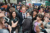 A Prince William lookalike mixes with the crowds outside Westminster Abbey on the eve of the Royal Wedding.