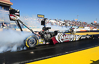 Feb. 17 2012; Chandler, AZ, USA; NHRA top fuel dragster driver Shawn Langdon (near lane) does a burnout alongside Clay Millican during qualifying for the Arizona Nationals at Firebird International Raceway. Mandatory Credit: Mark J. Rebilas-