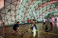 ANTARCTICA - NOVEMBER 26: Chinese, Chilean and Russian priests, scientists and logistics personnel play football in a dome gymnasium located under a large tent construction in the snow at the the President Eduardo Frei Montalva Base, the Chilean Air Force base, on the 26th of November, 2015 in the Fildes Peninsula on King George Island, Antarctica. <br /> <br /> Daniel Berehulak for The New York Times