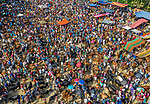 """Pictured: Thousands of people inspect cattle for purchase at a bustling market.   Around 15,000 visitors flocked to the annual cattle market where around 10,000 of the animals fetch up to £3,000 each.<br /> <br /> Photographer Abdul Momin's aerial shots of the two-day event in Bogra, Bangladesh, show it teeming with activity.   Mr Momin, 29, from Bogra, said: """"It's a temporary market, only arranged once a year for the [Islamic holiday] Eid-ul-adha.   SEE OUR COPY DETAILS <br /> <br /> Please byline: Abdul Momin/Solent News<br /> <br /> © Abdul Momin/Solent News & Photo Agency<br /> UK +44 (0) 2380 458800"""