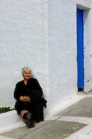 An old women resting in the afternoon, Santorini, Greece
