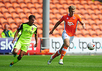 Blackpool's Brad Potts under pressure from Exeter City's Lee Holmes<br /> <br /> Photographer Kevin Barnes/CameraSport<br /> <br /> Football - The EFL Sky Bet League Two - Blackpool v Exeter City - Saturday 6th August 2016 - Bloomfield Road - Blackpool<br /> <br /> World Copyright &copy; 2016 CameraSport. All rights reserved. 43 Linden Ave. Countesthorpe. Leicester. England. LE8 5PG - Tel: +44 (0) 116 277 4147 - admin@camerasport.com - www.camerasport.com