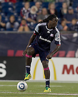 New England Revolution midfielder Shalrie Joseph (21) looks to pass. In a Major League Soccer (MLS) match, the San Jose Earthquakes defeated the New England Revolution, 2-1, at Gillette Stadium on October 8, 2011.