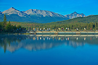 Tourists crossing the bridge on Pyramid Lake with the Canadian Rockies in the background<br />