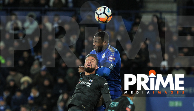 Olivier Giroud of Chelsea & Wes Morgan of Leicester City  during the FA Cup QF match between Leicester City and Chelsea at the King Power Stadium, Leicester, England on 18 March 2018. Photo by Stephen Buckley / PRiME Media Images.