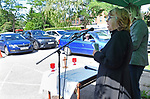 Pictured:  Reverend Claire Towns, of St Barnabas Church, led the unique drive-in service, which began at 10am in Swanmore, Hants, along with lay minister Sally Beazley, 55.<br /> <br /> A church today hosted its first ever drive-in service, with a vicar leading the event from a car park.  Around 40 cars full of worshipers gathered outside a village hall to hear music and listen to the words of the minister.<br /> <br /> Everyone in the vehicles put their driver side window down, so they could join in with the singing, but left the passenger window up to help with social distancing.  People put their hands through the sunroof of their cars and clapped along while reading from hymn sheets provided by the church.  SEE OUR COPY FOR DETAILS.<br /> <br /> © Simon Czapp/Solent News & Photo Agency<br /> UK +44 (0) 2380 458800