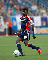 New England Revolution midfielder Clyde Simms (19) on the wing. In a Major League Soccer (MLS) match, DC United defeated the New England Revolution, 2-1, at Gillette Stadium on April 14, 2012.
