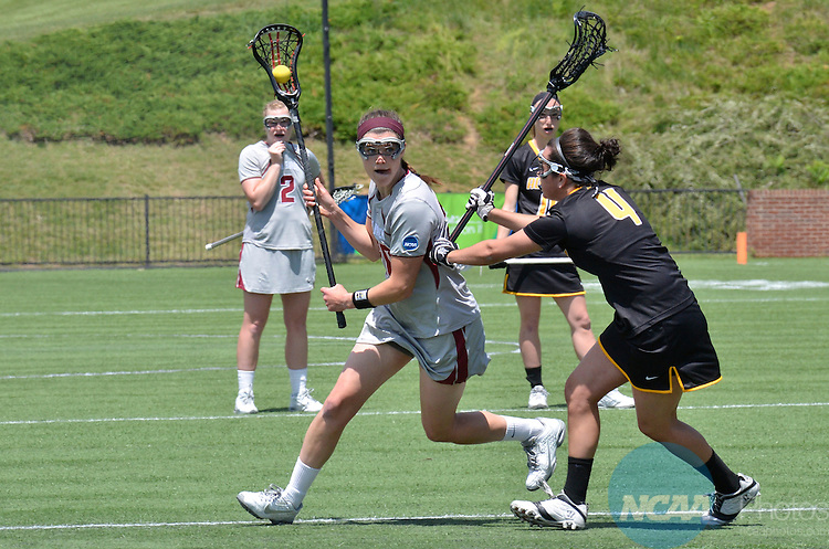18 MAY 2014: Loch Haven's Rachel Ward (20) is defended by Adelphi University Danielle Jaycox (4) at the Division II Women's Lacrosse Championship held at Kerr Stadium in Salem, VA.  Adelphi defeated Lock Haven 7-5 to win the national title.  Andres Alonso/NCAA Photos