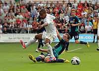 Saturday, 01 September 2012<br /> Pictured L-R: Wayne Routledge of Swansea tackled by Craig Gardner of Sunderland.<br /> Re: Barclays Premier League, Swansea City FC v Sunderland at the Liberty Stadium, south Wales.