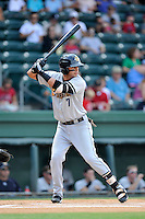 Designated hitter Angel Aguilar (7) of the Charleston RiverDogs bats in a game against the Greenville Drive on Sunday, August 16, 2015, at Fluor Field at the West End in Greenville, South Carolina. Charleston won, 6-2. (Tom Priddy/Four Seam Images)
