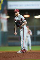 Arkansas Razorbacks relief pitcher Marshall Denton (29) looks to his catcher for the sign against the Texas Longhorns in game six of the 2020 Shriners Hospitals for Children College Classic at Minute Maid Park on February 28, 2020 in Houston, Texas. The Longhorns defeated the Razorbacks 8-7. (Brian Westerholt/Four Seam Images)