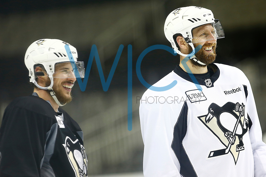 Eric Fehr #16 and Sidney Crosby #87 of the Pittsburgh Penguins share a laugh during practice at the SAP Center in San Jose, California on June 5, 2016. (Photo by Jared Wickerham / DKPS)