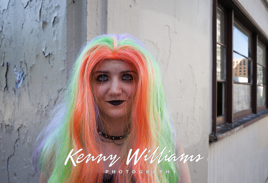 Portrait of goth girl wearing rainbow colored wig, Seattle PrideFest 2016, Pride Parade and Festival, Washington, USA.