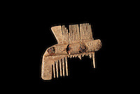 A double-sided comb made from bone with carved decoration, 10th - 11th centuries, from the 1994 excavations led by Francois Blary, from the North section of the upper courtyard in the kitchen area at the medieval castle of Chateau-Thierry, Picardy, France. The first fortifications on this spur over the river Marne date from the 4th century and the first castle was built in the 9th century Merovingian period by the counts of Vermandois. Thibaud II enlarged the castle in the 12th century and built the Tour Thibaud, and Thibaud IV expanded it significantly in the 13th century to include 17 defensive towers in the walls and an East and South gate. The castle was largely destroyed in the French Revolution after having been a royal palace since 1285. In 1814 it was used as a citadel for Napoleonic troops. Picture by Manuel Cohen