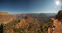 This image is a panoramic composite image taken along the South Kaibab Trail at Grand Canyon National Park. The hiker ahead on the trail is my wife Lori. And that's me in the bottom left corner in shadow.