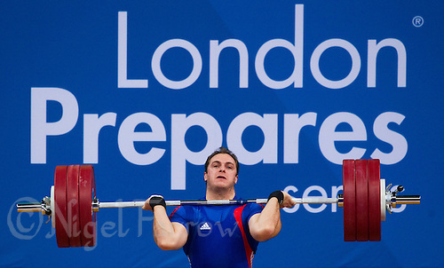 11 DEC 2011 - LONDON, GBR - Kevin Bouly (FRA) lifts during the men's +105kg category Clean and Jerk at the London International Weightlifting Invitational and 2012 Olympic Games test event held at the ExCel Exhibition Centre in London, Great Britain .(PHOTO (C) NIGEL FARROW)