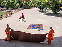 Buddhist Monks cleaning carpets after their lunch at a Monastery on the outskirts of Phnom Penh, Cambodia Chin Puskak, Temple,
