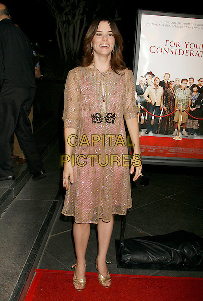 "PARKER POSEY.""For Your Consideration"" Los Angeles Premiere held at the Directors Guild Of America, West Hollywood, California, USA..November 13th, 2006.Ref: ADM/RE.full length pink beige sheer dress.www.capitalpictures.com.sales@capitalpictures.com.©Russ Elliot/AdMedia/Capital Pictures."