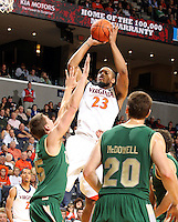 Nov. 12, 2010; Charlottesville, VA, USA;  Virginia Cavaliers forward Mike Scott (23) shoots over William & Mary Tribe forward Marcus Kitts (45) and William & Mary Tribe g-f Quinn McDowell (20) during the game at the John Paul Jones Arena. Virginia won 76-52.  Mandatory Credit: Andrew Shurtleff