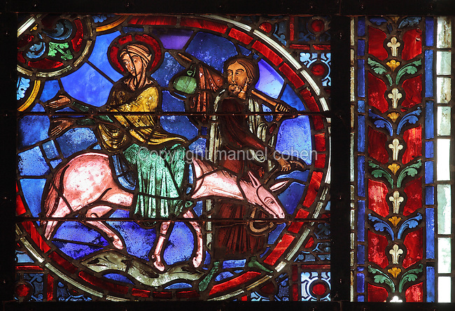 The flight to Egypt, with Joseph leading a donkey carrying the Virgin, early 12th century, lancet stained glass window from the apse of Laon Cathedral or the Cathedrale Notre-Dame de Laon, built 12th and 13th centuries in Gothic style, in Laon, Aisne, Picardy, France. The cathedral is listed as a historic monument. Picture by Manuel Cohen