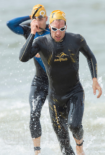13 JUL 2013 - DEN HAAG, NED - Jim Thijs (BEL) of Belgium runs from the sea at the end of the swim during the 2013 ITU Elite Men's Cross Triathlon World Championships in Kijkduin, Den Haag (The Hague), the Netherlands (PHOTO COPYRIGHT © 2013 NIGEL FARROW, ALL RIGHTS RESERVED)