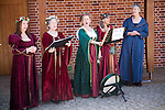 Sweet Harmonie female singing group in Tudor costume performing at Layer Marney Tower, Essex, England