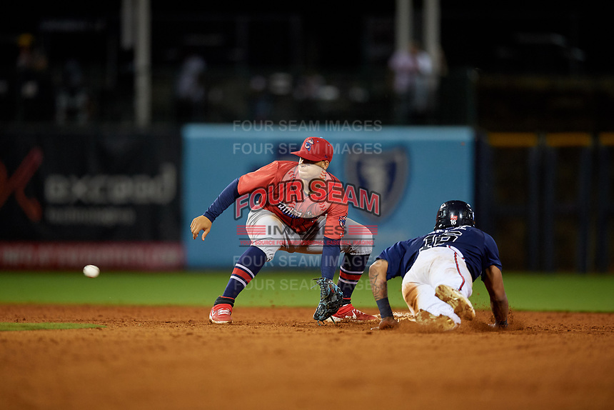 Jacksonville Jumbo Shrimp shortstop Joe Dunand (3) waits for a throw from the catcher as Cristian Pache (16) unsuccessfully attempts to steal second base during a Southern League game against the Mississippi Braves on May 4, 2019 at Trustmark Park in Pearl, Mississippi.  Mississippi defeated Jacksonville 2-0.  (Mike Janes/Four Seam Images)