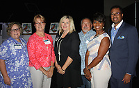 NWA Democrat-Gazette/CARIN SCHOPPMEYER Treva Kennedy (from left), Evelyn Jorgenson, Northwest Arkansas Community College president, Mary and Alan Jordan and Andrea and Todd Kitchen represent the community college at Spark of Hope on June 22.