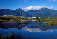 Kanaha Pond reflects the West Maui Mountains on a calm day.