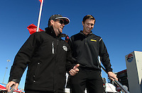 Oct. 26, 2012; Las Vegas, NV, USA: NHRA top fuel dragster driver Shawn Langdon (left) with Morgan Lucas during qualifying for the Big O Tires Nationals at The Strip in Las Vegas. Mandatory Credit: Mark J. Rebilas-