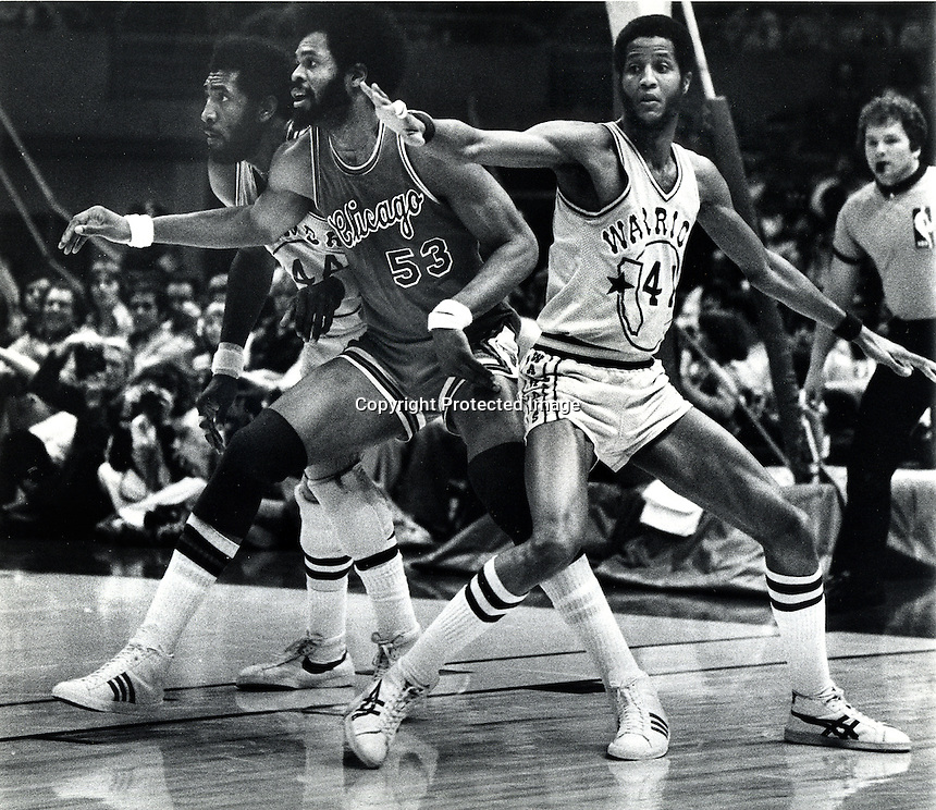 Golden State Warriors vs Chicago Bulls March 6,1977<br />Clifford Ray, Bulls Artis Gilmore #53  and Jamaal (Keith) Wilkes. (photo/Ron Riesterer/Photoshelter)