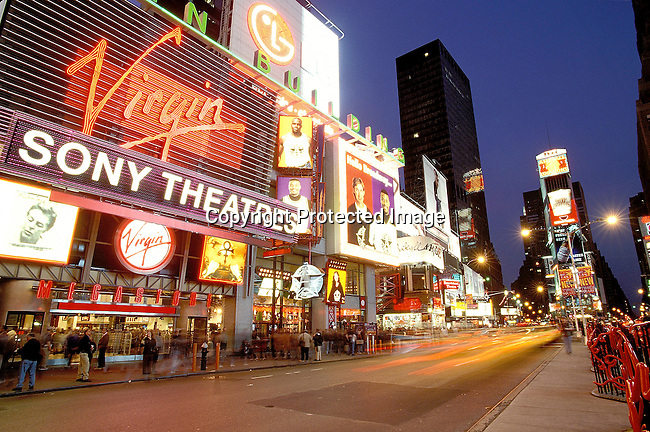 COAMENY35050.Country.  America.  New York.  The newly remodeled Times Square.  Theatres, neon lights, billboards, traffic, cars, high rise buildings. 97..©Per-Anders Pettersson / iAfrika Photos.