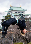 "Ninja Chris  ""Sora"" O'Neil performs a backflip in the grounds of Nagoya Castle, Aichi Prefecture Japan on Feb. 23, 2017. O'Neil is one of the eight ninja corps who roam the avenues of the castle and Nagoya Airport, jumping from behind trees and bushes to surprise visitors. ROB GILHOOLY PHOTO"