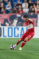 FOXBOROUGH, MA - AUGUST 25: Brandt Bronico #13 of Chicago Fire passes the ball during a game between Chicago Fire and New England Revolution at Gillette Stadium on August 24, 2019 in Foxborough, Massachusetts.