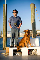 Captain Joe and his dog at the dock at Wrightsville.