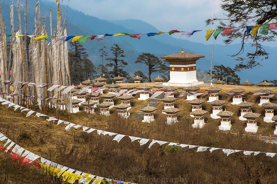 prayer flags and chorten at Dochula Pass, Bhutan