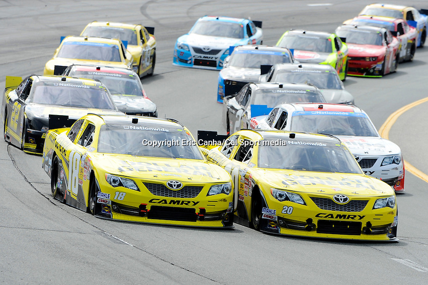 "July 13, 2013 - Loudon, New Hampshire U.S. - Nationwide Series driver Matt Kenseth (18) and driver Brian Vickers (20) racing in the NASCAR Nationwide Series CNBC Prime's ""The Profit"" 200 race being held at the New Hampshire Motor Speedway in Loudon, New Hampshire.   Eric Canha/CSM"