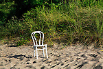 Beach Grass And A Chair On The Beach At The Presque Isle Lighthouse On A Warm Summer Afternoon Along Lake Erie At Erie Pennsylvania, USA