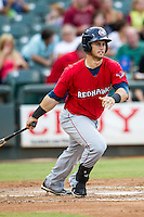 Oklahoma City RedHawks outfielder Preston Tucker (12) follows through on his swing during the Pacific Coast League baseball game against the Round Rock Express on August 1, 2014 at the Dell Diamond in Round Rock, Texas. The Express defeated the RedHawks 6-5. (Andrew Woolley/Four Seam Images)