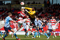 Doncaster Rovers v Coventry City, 23.4.2016<br /> Sky Bet League One<br /> Picture Shaun Flannery/Trevor Smith Photography<br /> Coventry goal keeper, Reice Charles-Cook clears the ball from Rovers Craig Alcock.