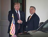 United States President Donald J. Trump, left, shakes hands with Prime Minister Viktor Orban of Hungary, right, as he welcomes him to the White House in Washington, DC on Monday, May 13, 2019.  The two leaders will meet for about an hour.<br /> Credit: Ron Sachs / CNP