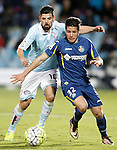Getafe's Emi Buendia (r) and Celta de Vigo's Nolito during La Liga match. February 27,2016. (ALTERPHOTOS/Acero)