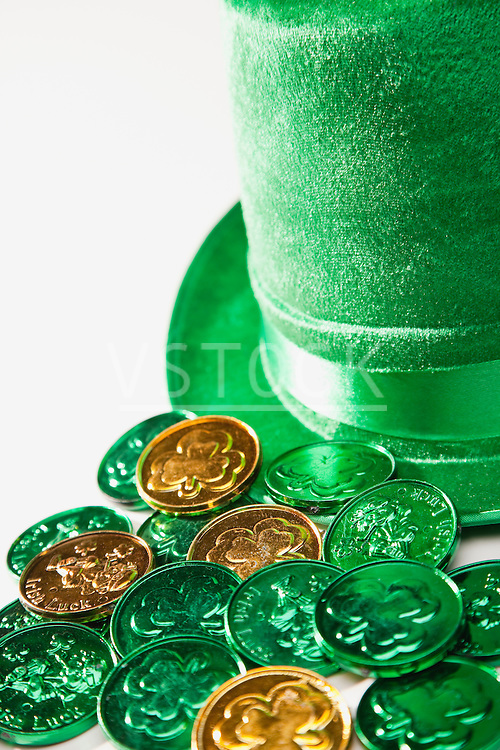 Gold and green coins with irish shamrock symbol